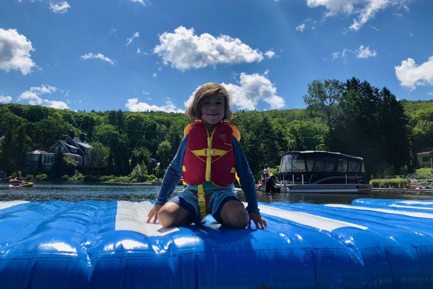 Laughter is universal: Kids speaking several languages all played together on the popular giant lake raft.