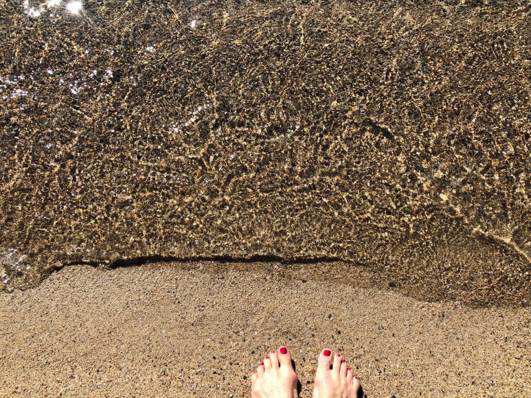 Snow melted and my toes are in the sand. That clear Tahoe water though...