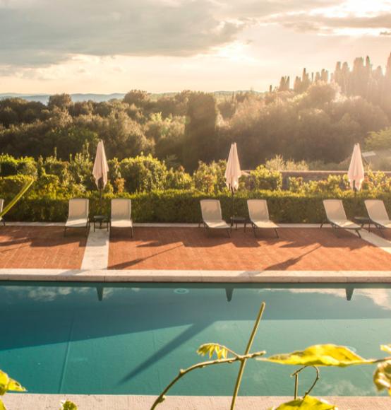 Golden hour over the Italian countryside. Time for an Aperol Spritz. Oh pool boy! {Photo: Borgo Scopeto Relais}