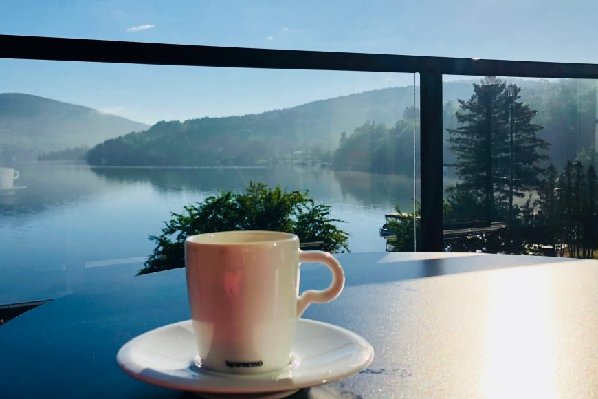 Room with a view: Balcony overlooking the beautiful blues and greens of Lac Beauport.