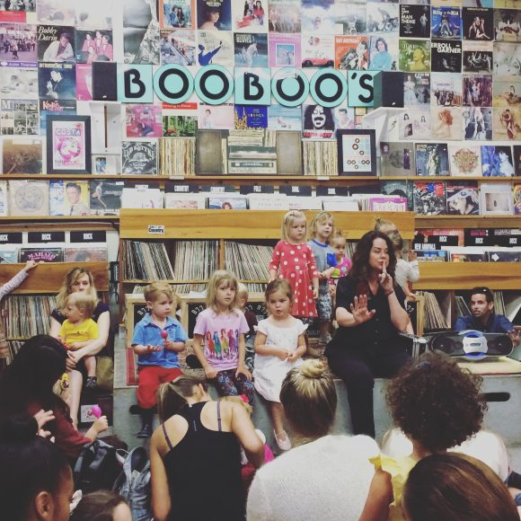Mayor Heidi Harmon singing with the kiddos and their hip mamas and papas at Boo Boo Records.